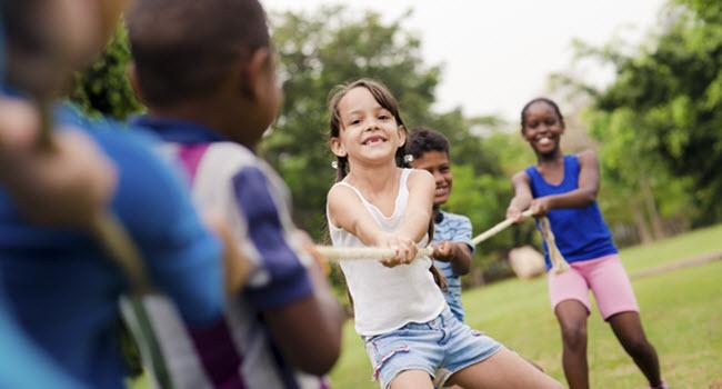Kids Playing Tug of War in Summer Camp