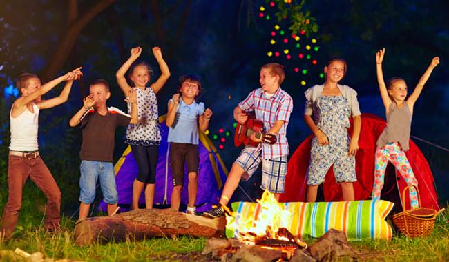 Kids Dancing Around Campfire