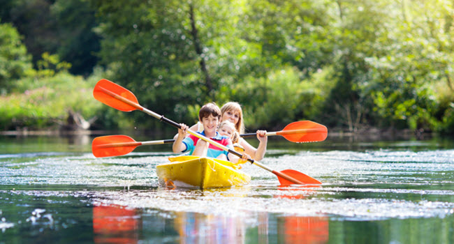 Kids On Canoe At Summer Camp