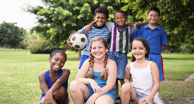 Culturally-Diverse Group Of Kids At Summer Camp
